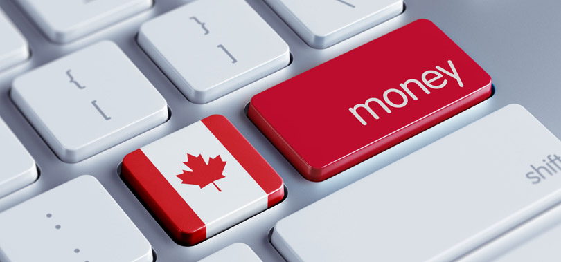 Canada flag on keyboard with word money