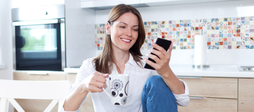 Women accessing ACOP's website on her phone
